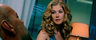 Utterly dependent on her beautician surrogate, Greer's wife Maggie (Rosamund Pike) is a bit disturbed to see her husband in his own flesh.