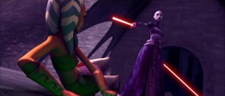 No ordinary catfight... the bald Mistress Ventress uses one of her two red lightsabers to make a point to her fallen opponent Ahsoka.