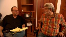 "In ""A New Score"", composer Kevin Kiner is happy to sit next to George Lucas, even if the flannel-clad creator looks ready to get up."