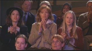 Concerned and befuddled mother (Susan Sarandon) and daughter (Tamara Hope) watch Dad on the dance floor.