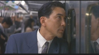 Mr. Sugiyama likes to peer out the train door windows.