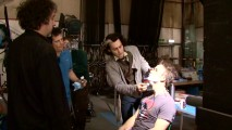 "Johnny Depp gets a lesson at the Tim Burton School of Barbering in the single-disc's lone extra, ""Burton + Depp + Carter = Todd."""
