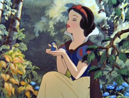 Snow White holds a blue bird in her hands.