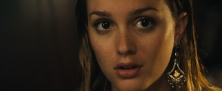 Rebecca (Leighton Meester), the roommate, admires the way a dangling earring looks on her newly self-pierced lobe.