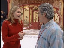 The director chats with Mrs. Calvin/Clause to convince Disney that all is well inside the North Pole.