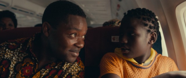 Phiona (Madina Nalwanga) gets her first look at the clouds from an airplane she rides alongside her coach Robert Katende (David Oyelowo).