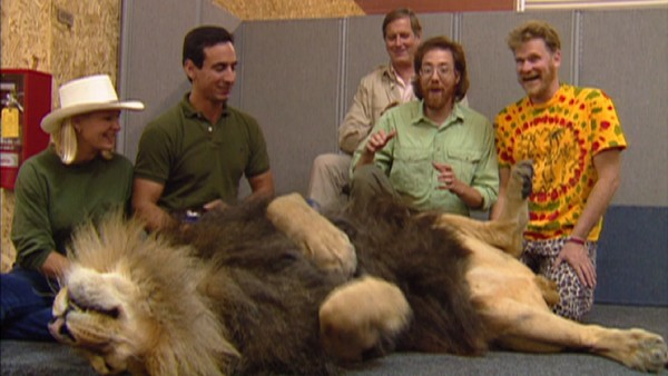 "Directors Rob Minkoff and Roger Allers are among those getting an up-close look at a sleepy lion during the making of ""The Lion King."""