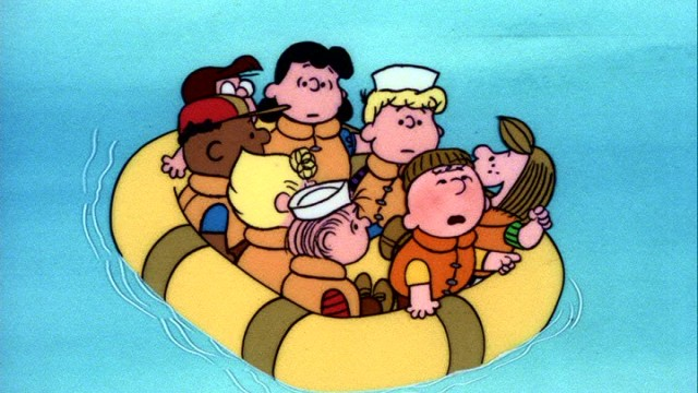 "Eight members of the Peanuts gang share a raft in the camp movie ""Race for Your Life, Charlie Brown."""