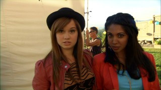 "Debby Ryan and Sarena Parmar ask and answer ""Who is Radio Rebel?"""