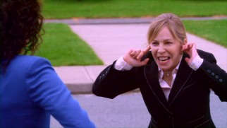 Nasty Principal Moreno (Nancy Robertson) does not take kindly to SLAM FM's lunch time jam van stunt.