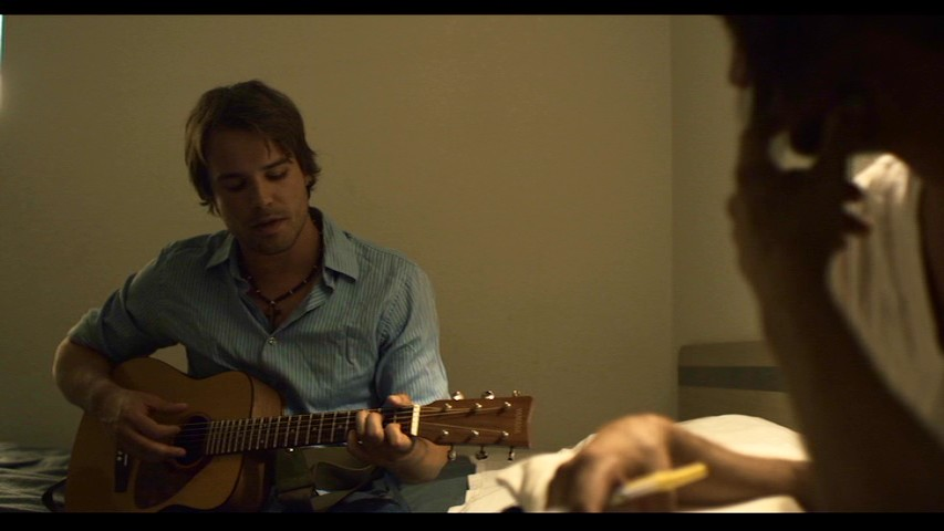 Rich Mullins' protégé and friend Justin (Carson Aune) plays a song for him on the road in this deleted scene.