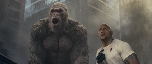 "In the film ""Rampage"", primatologist Davis Okoye (Dwayne Johnson) stands by his friend George, an albino silverback gorilla who begins growing and growing more aggressive."