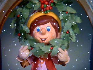 "Pinocchio celebrates Christmas with a wreath in ""Pinocchio's Christmas."""