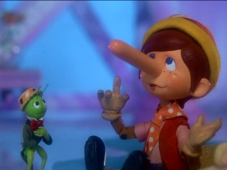 Lies make Pinocchio's nose grow before the talking cricket's eyes.