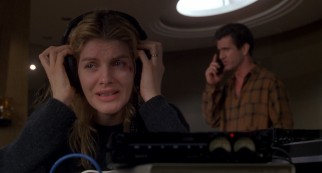 A freshly-bruised Kate Mullen (Rene Russo) listens anxiously as her husband makes a bold judgment call with the man who has kidnapped their son.