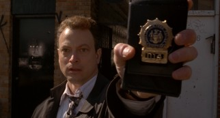 With a flash of his badge, Jimmy Shaker (Gary Sinise) reminds us he is a New York City cop gone bad.