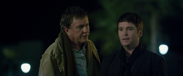 "In ""Reach Me"", reclusive author Teddy Raymond (Tom Berenger) helps blog underling Roger King (Kevin Connolly) quit smoking."