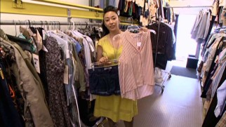 "Costume designer Ane Crabtree shows off some of Amantha's wardrobe in an ""Inside Job: Behind the Scenes"" short."