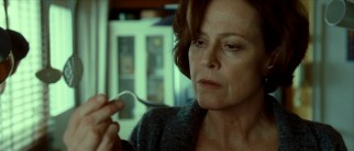 Skeptical Dr. Margaret Matheson (Sigourney Weaver) has a scientific answer for everything paranormal except this bent spoon.