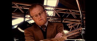 Paul Shackleton (Toby Jones) strikes a skeptical pose during Silver's scientific evaluation, presented as a windowboxed academic short documentary.