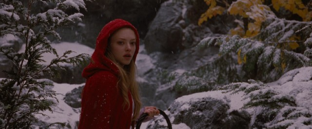 With basket in hand, Amanda Seyfried stars as Valerie, the young wearer of the titular red riding hood.