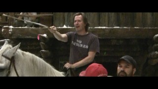 "A clean-shaven, horseback Gary Oldman rides into a scene rehearsal in a ""No Pictures"" shirt."