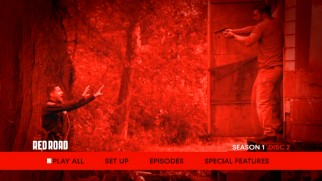 "Disc 2's main menu drenches a scene from ""The Red Road"" in the titular hue."