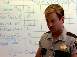 In his morning briefing, Lt. Jim Dangle (Thomas Lennon) briefs his officers on how he'll be deciding who gets two tickets to an execution.