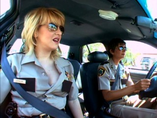 Deputies Clementine Johnson (Wendi McLendon-Covey) and Trudy Wiegel (Kerri Kenney-Silver) patrol Reno together.