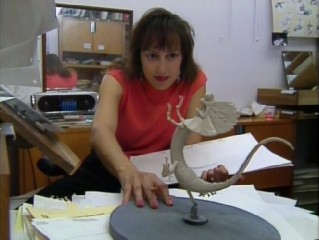 "Supervising animator Kathy Zielinski consults a model while drawing Frank in ""The Making of 'The Rescuers Down Under'."""