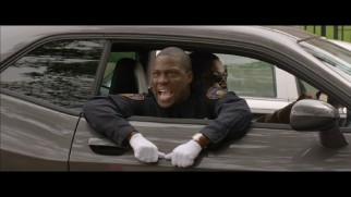 Ben (Kevin Hart) graduates from the Police Academy in this alternate ending.