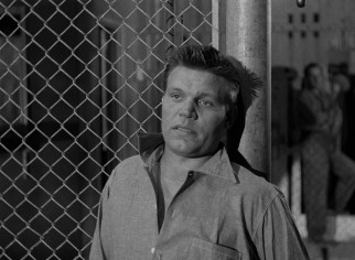 Veteran convict Dunn (Neville Brand) speaks on behalf of the rioting prisoners.