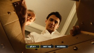 John Lithgow and James Franco unbox the DVD main menu, shocked by the lack of bonus features.