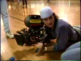 "Director Robert Rodriguez gets low to shoot a ""RoadRacers"" roller rink scene in the behind-the-scenes footage from ""Ten Minute Film School: The Making of a Degenerate Hot Rod Flick."""