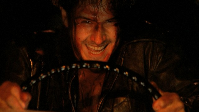 "A bloodied Dude (David Arquette) chuckles maniacally in the closing shot of ""Roadracers."""