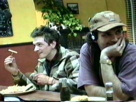Director Robert Rodriguez dons headphones, a University of Texas hat, and a smile, sitting next to John Hawkes rehearsing his memorable French fry philosophy scene.
