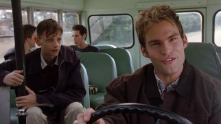 E.L. (Seann William Scott) mans the wheel of the blind school's school bus he stole.