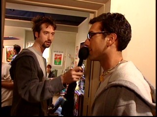 "Tom Green holds the microphone a little too close to director Todd Phillips' mouth in the making-of short ""Ever Been on a Road Trip?"""
