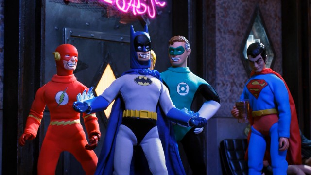 Justice League of America superheroes The Flash, Batman, Green Lantern, and Superman try picking up chicks at a bar while in costume.