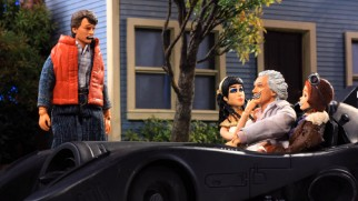 Back from the past, Doc Emmett Brown (with Cleopatra and Amelia Earhart) finally wins Marty McFly's approval of his vehicle.