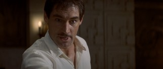 Timothy Dalton sports a mustache as movie star Neville Sinclair, who quotes his films in his seduction of starlets.