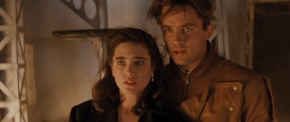 Jenny (Jennifer Connelly) and Cliff (Billy Campbell) face danger inside a zeppelin in the film's climax.