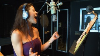 Catherine Zeta-Jones records a song in a behind-the-scenes music featurette.