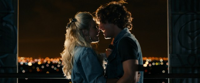 Aspiring singers Sherrie (Julianne Hough) and Drew (Diego Boneta) duet behind the Hollywood sign and above the bright lights of Los Angeles.
