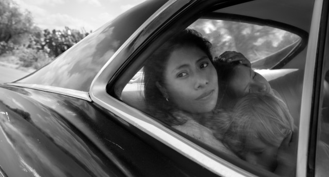 "Alfonso Cuaron's ""Roma"" (#1) looks at a 1970s Mexican family from the perspective of its live-in housekeeper Cleo (Yalitza Aparicio)."
