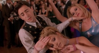 "Romy (Mira Sorvino), Michele (Lisa Kudrow), and nerd turned billionaire Sandy Frink (Alan Cumming) show all their classmates how it is with a three-way dance number to ""Time After Time."""