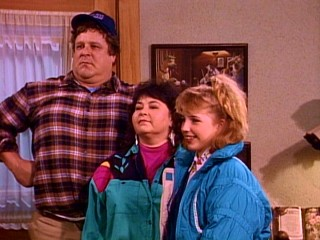 John Goodman, Roseanne Barr, and Alicia Goranson horse around in the Bloopers reel.