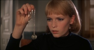 Rosemary Woodhouse (Mia Farrow) inspects the foul-smelling tannis root necklace she has been given by her neighbors.