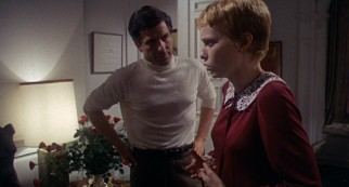 Rosemary's abdominal pains come to an immediate stop as she is talking to Guy (John Cassavetes) one night.