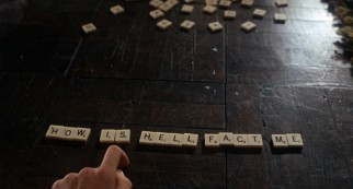 Rosemary consults Scrabble tiles to uncover a meaningful cautionary Anagram.